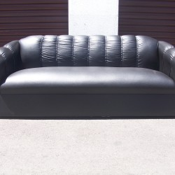 Florence triple seater in black leatherette, with short black plastic legs.